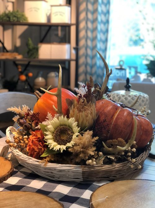 Pumpkins and antlers centerpiece