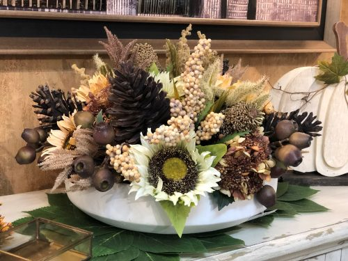 Fall centerpiece with pinecones and sunflowers