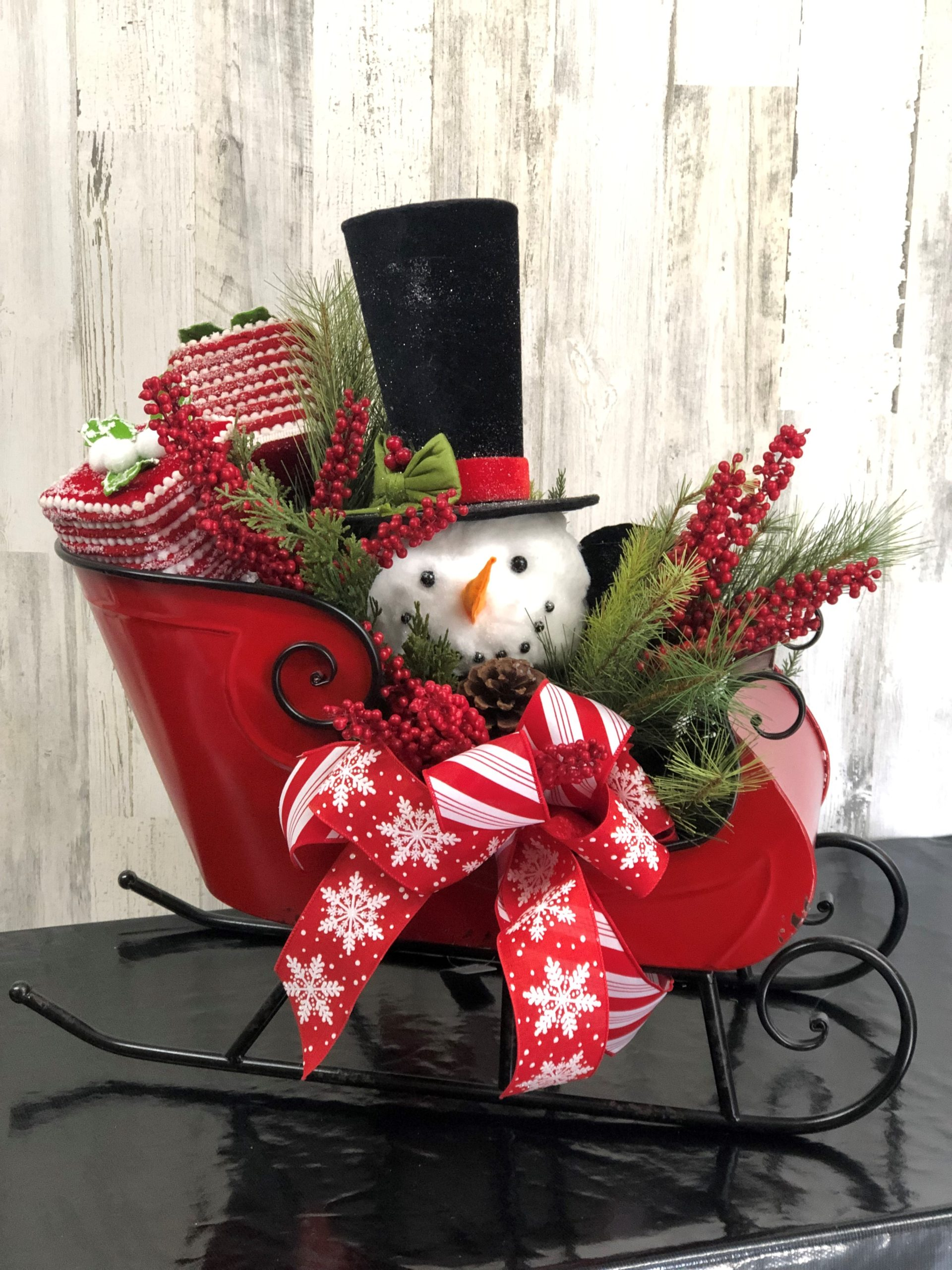 Red sleigh with top hat snowman