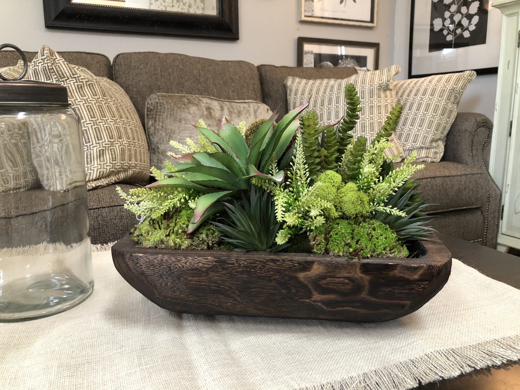 Mixed succulent arrangement in wooden square bowl