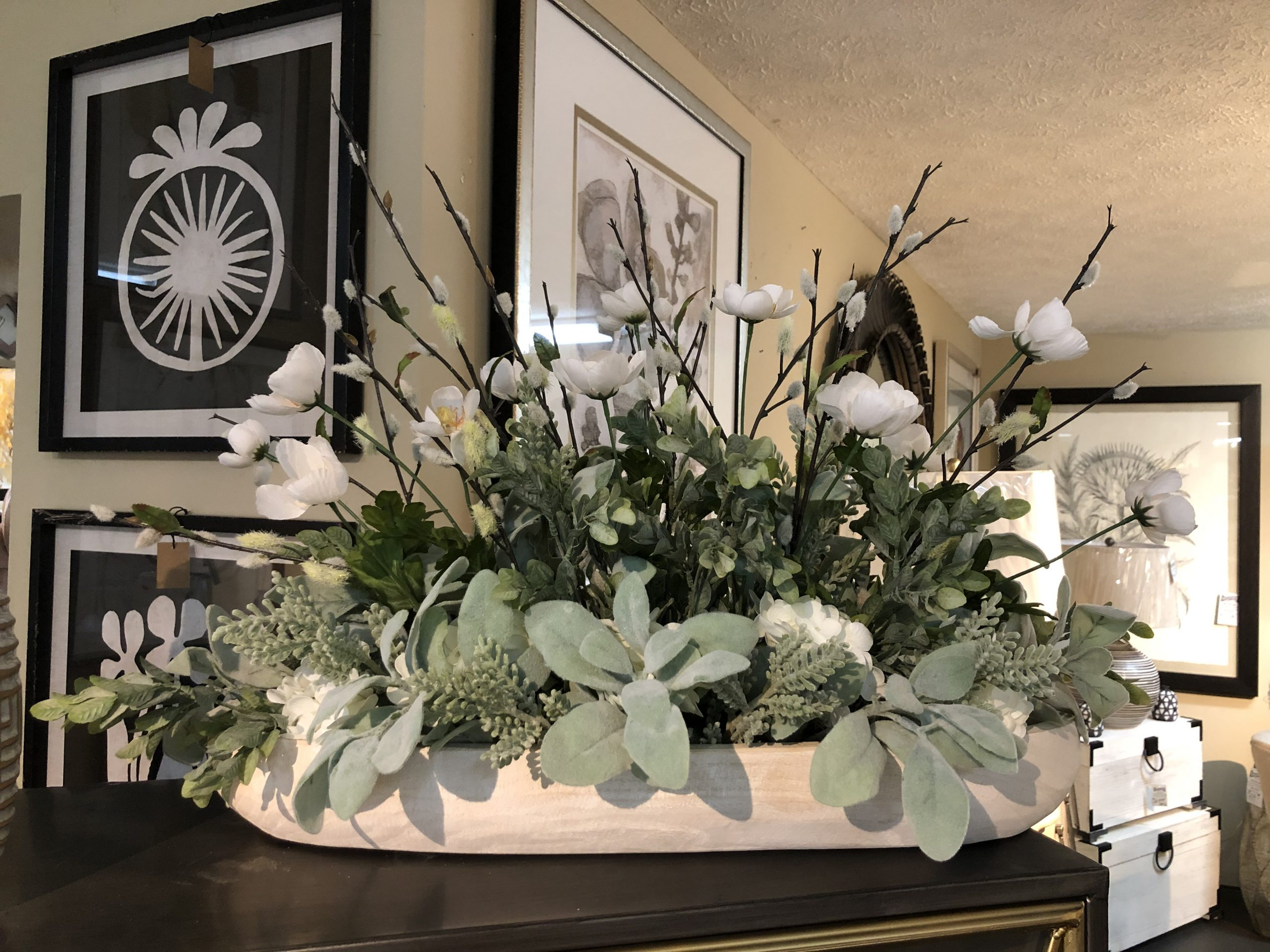 Whispie in white faux floral arrangement