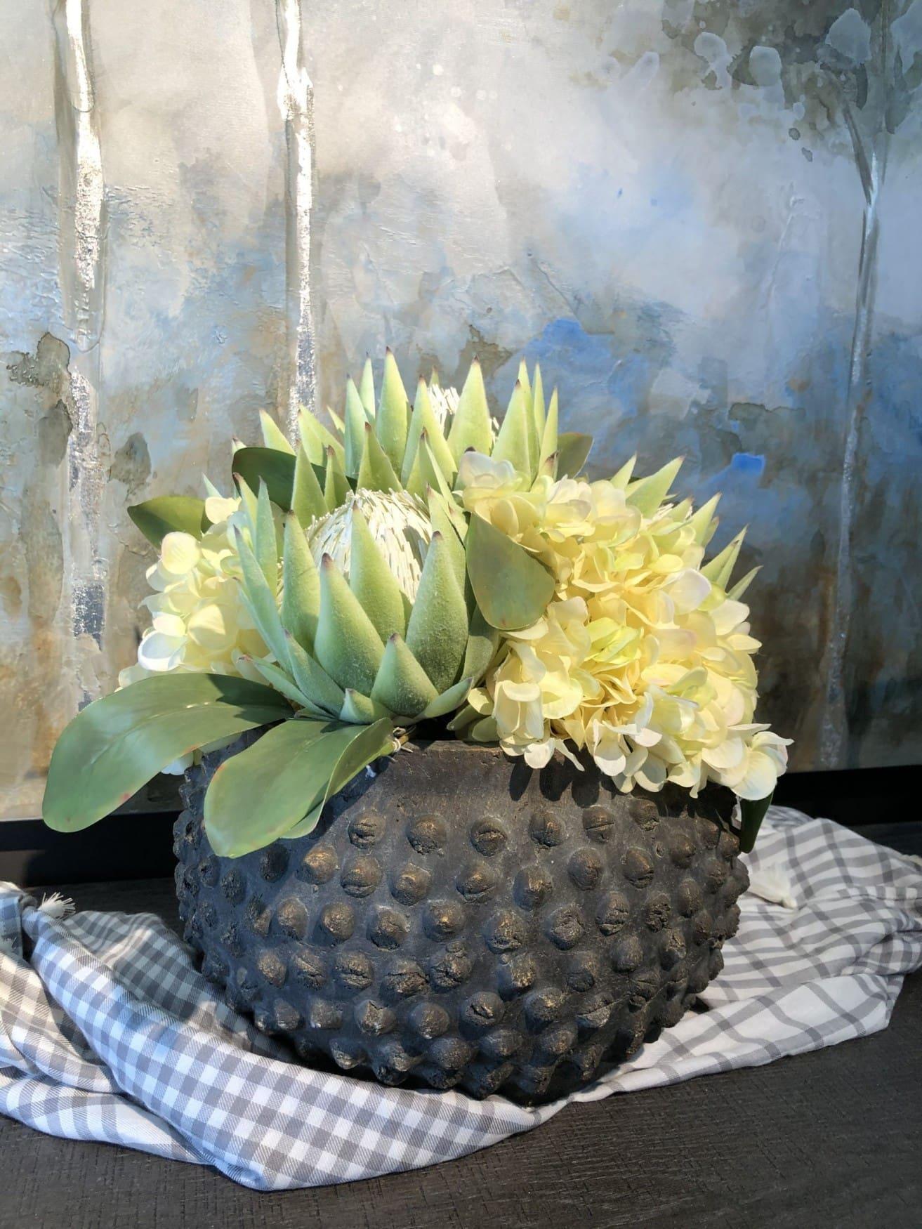 protea with yellow hydrangeas